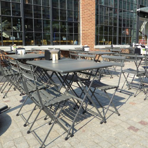 gray outdoor folding chairs and tables