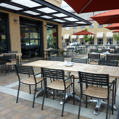 outdoor teak armchair and table for restaurant